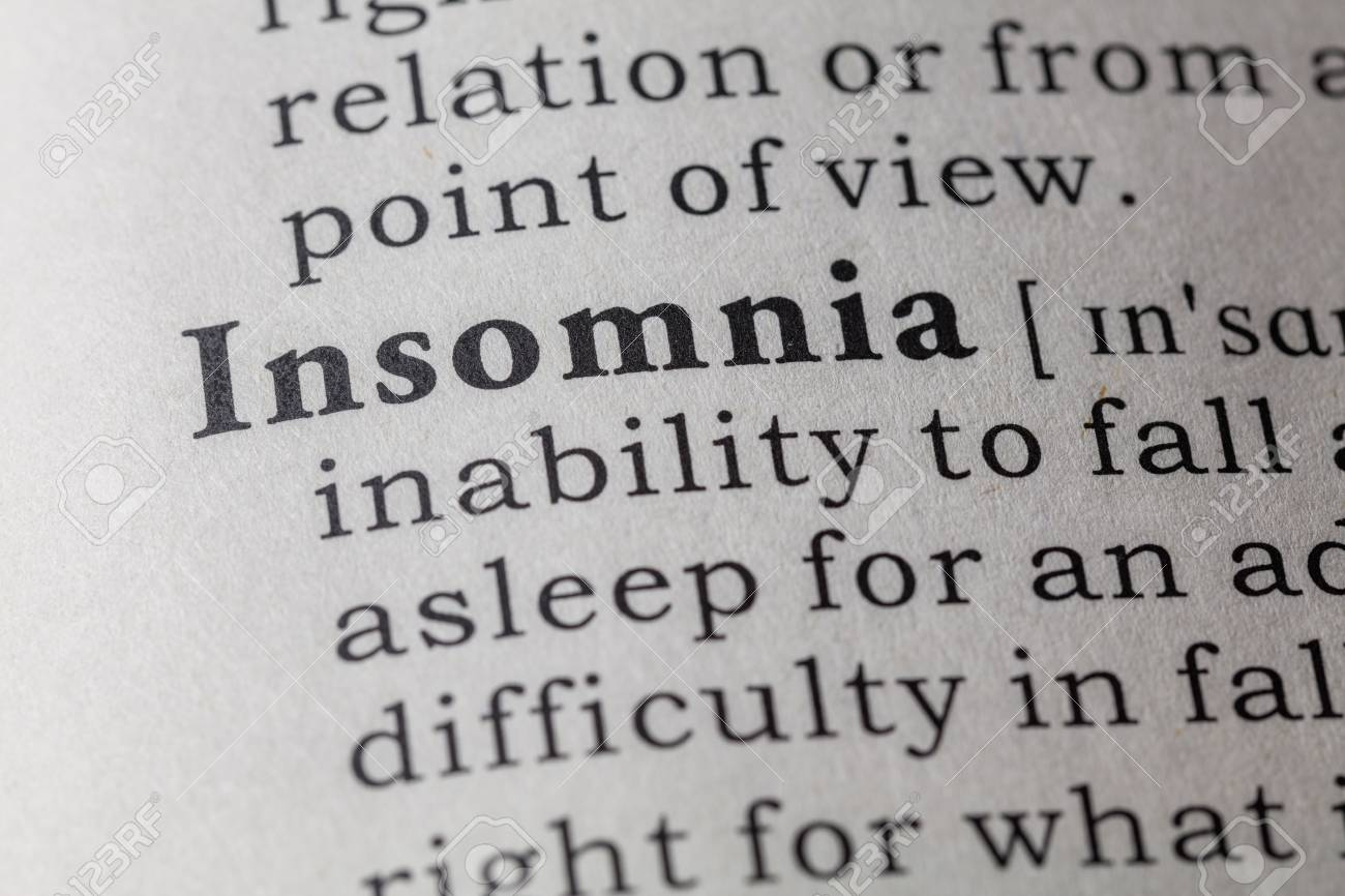 fake dictionary, dictionary definition of the word insomnia. stock