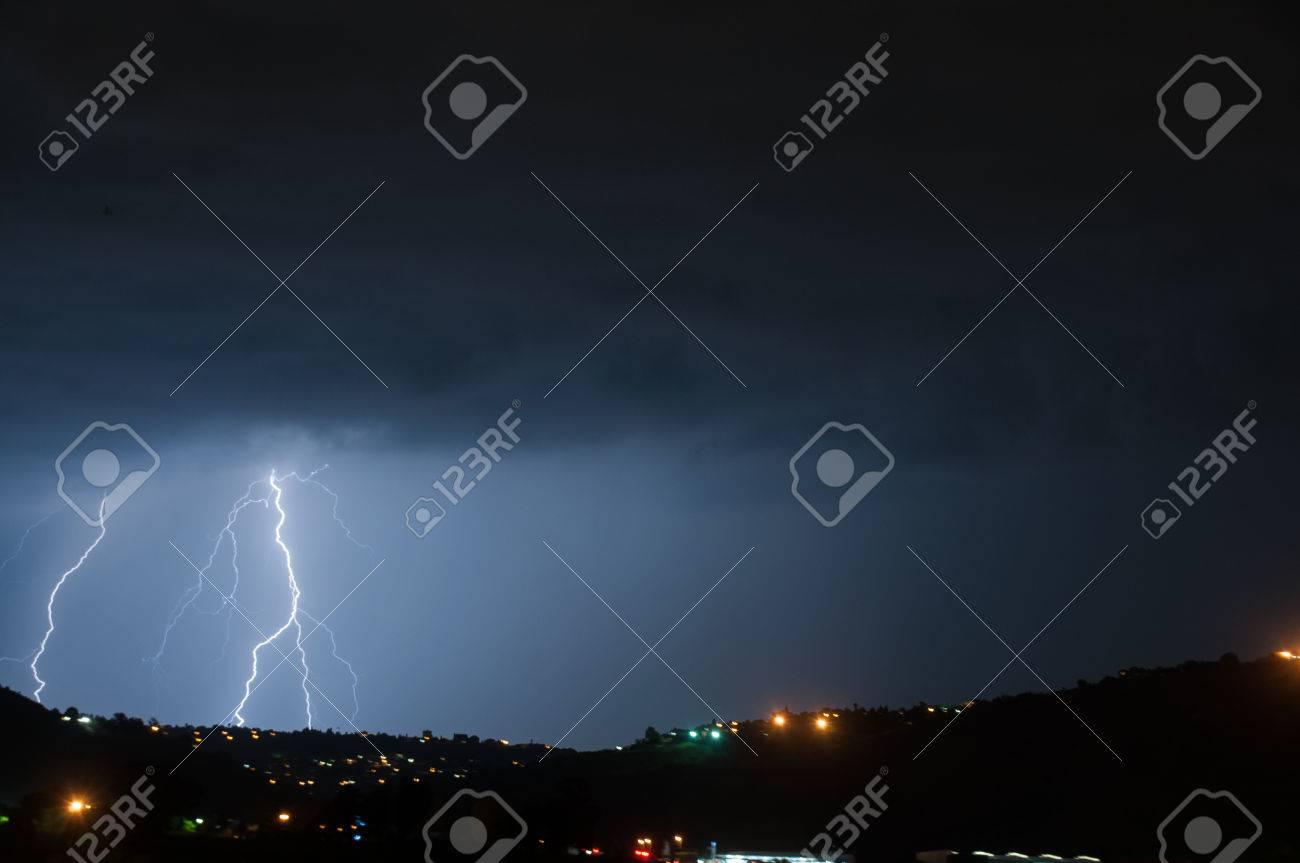 Cloud to ground lightning lighting up the night skies Stock Photo - 46937929