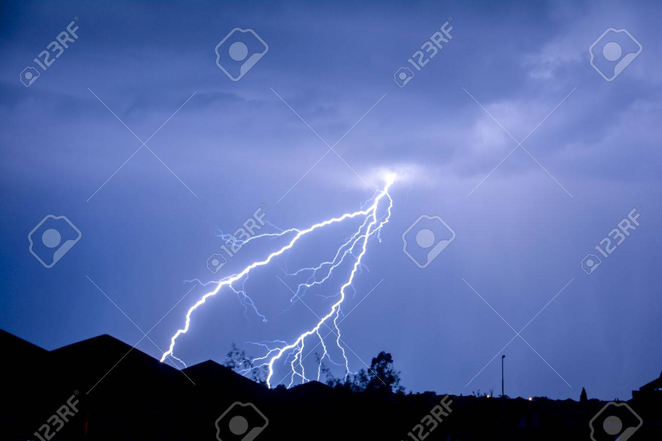 cloud to ground forked lightning strike stock photo picture and