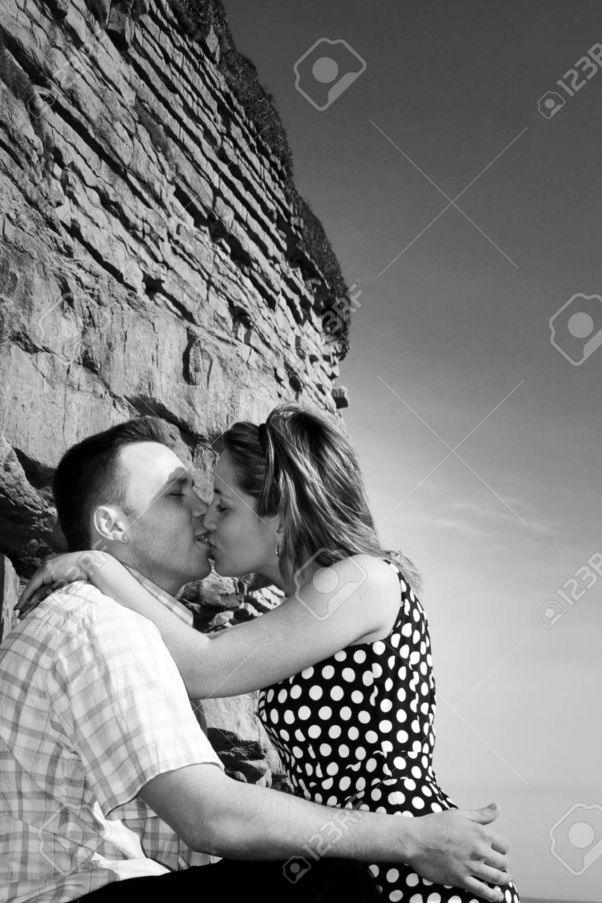 loving couple kissing under rocks celebrates engagement Stock Photo - 8631648