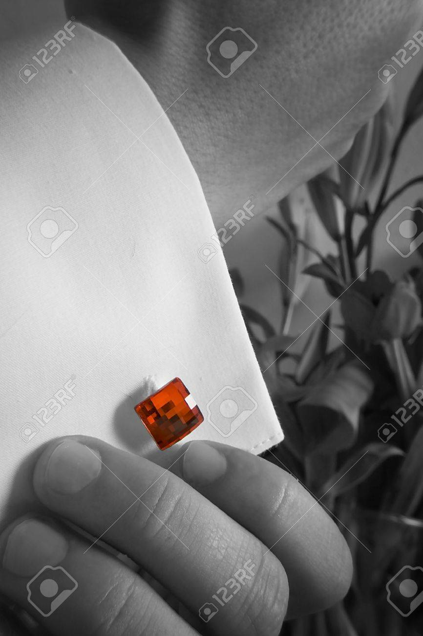 groom pin his red cufflink to the sleeve Stock Photo - 8671041