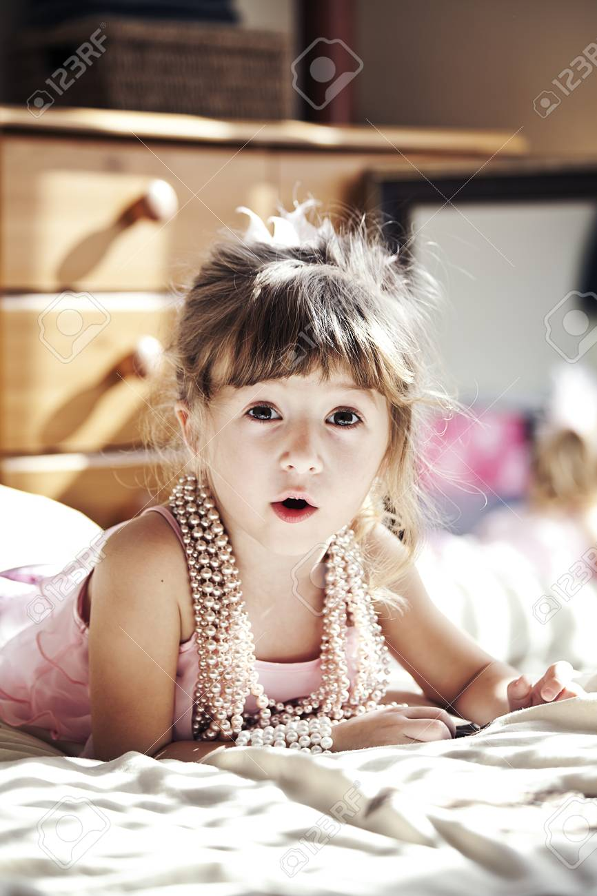 little cute girl poses with pearl necklace Stock Photo - 9179745
