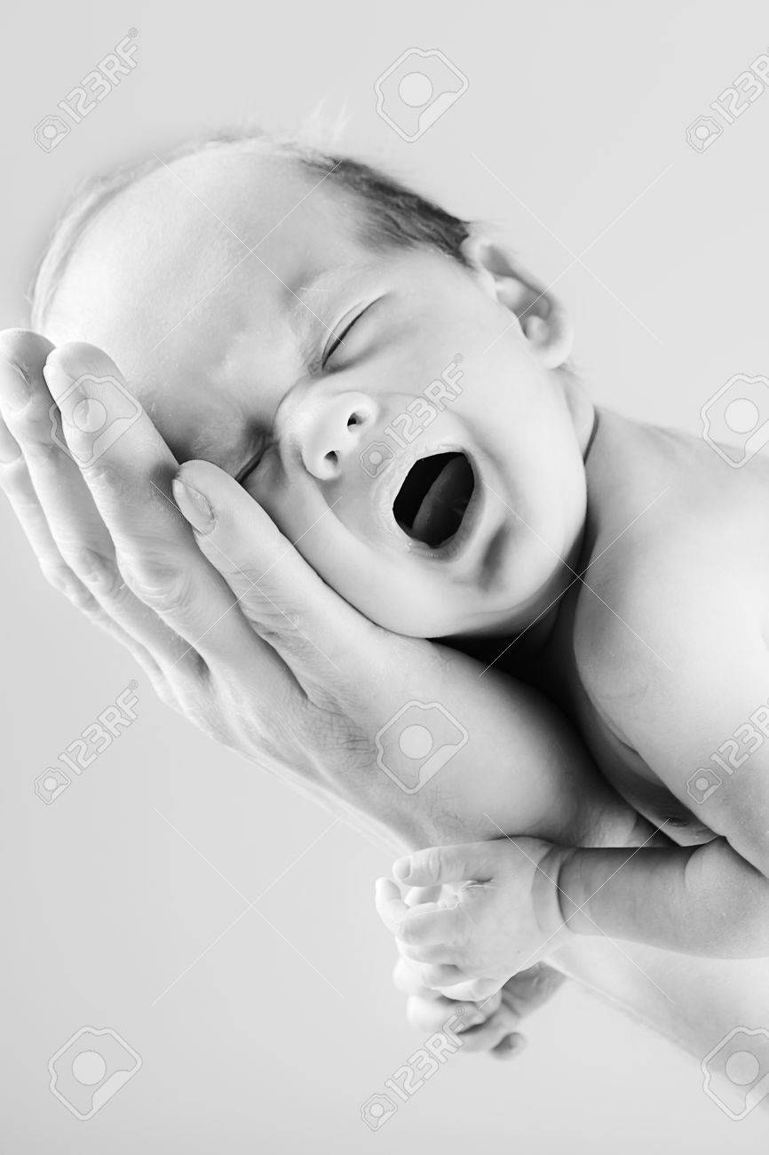 little crying baby on the father's hand in black and white Stock Photo - 9236042