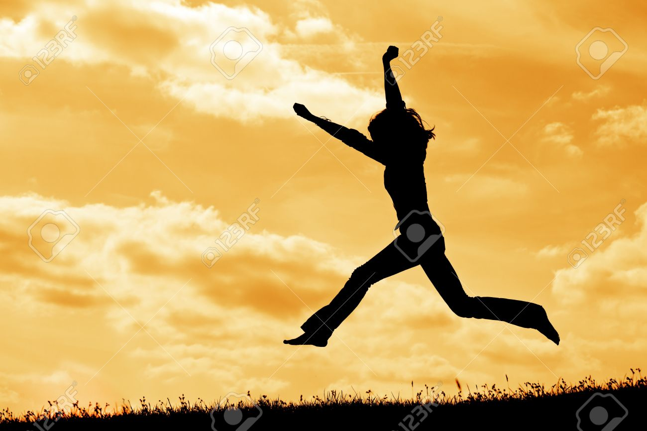 silhouette of jumping woman on the sky background - 9448383