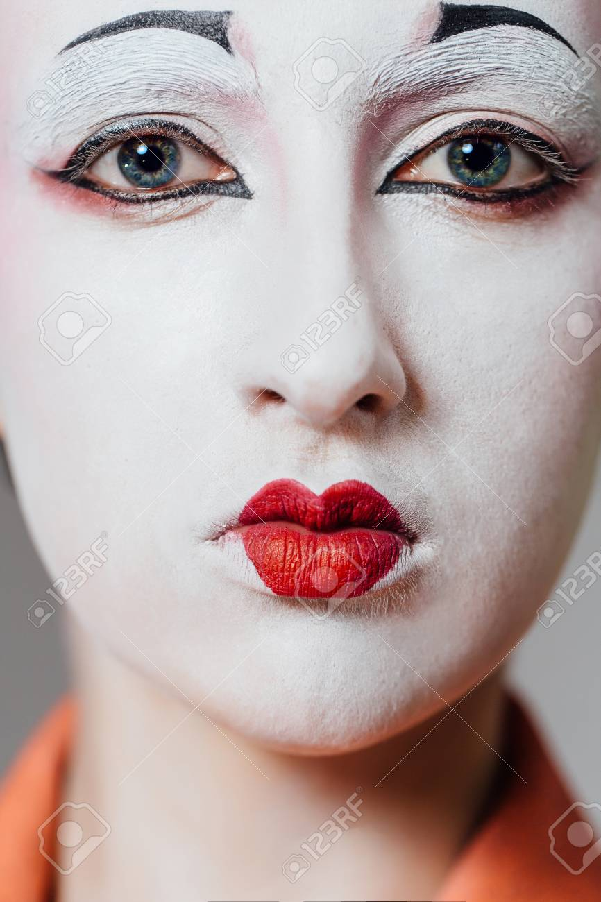 Stock Photo - Woman in geisha makeup and a traditional Japanese kimono. Studio, Indoor.