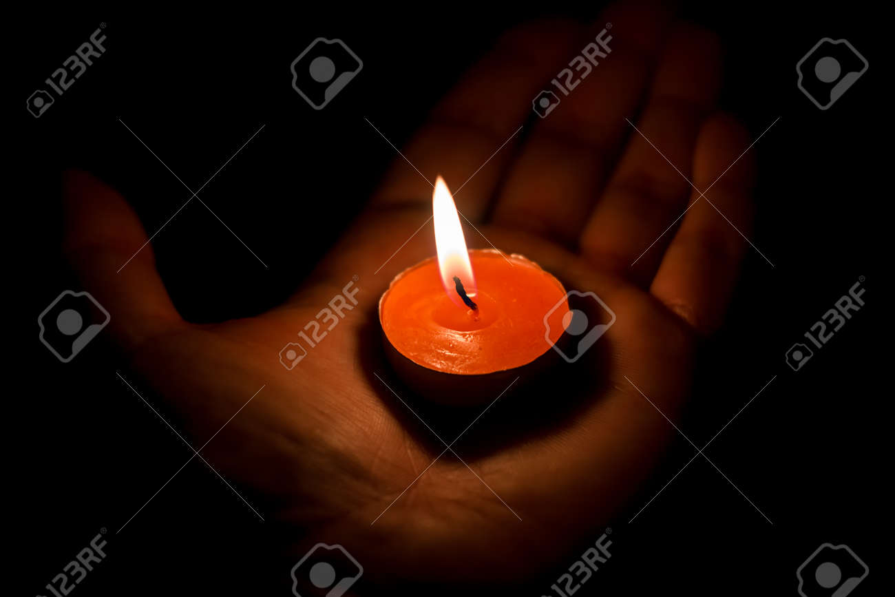 Burning candle on the palm, sorrow and memory - 159423809