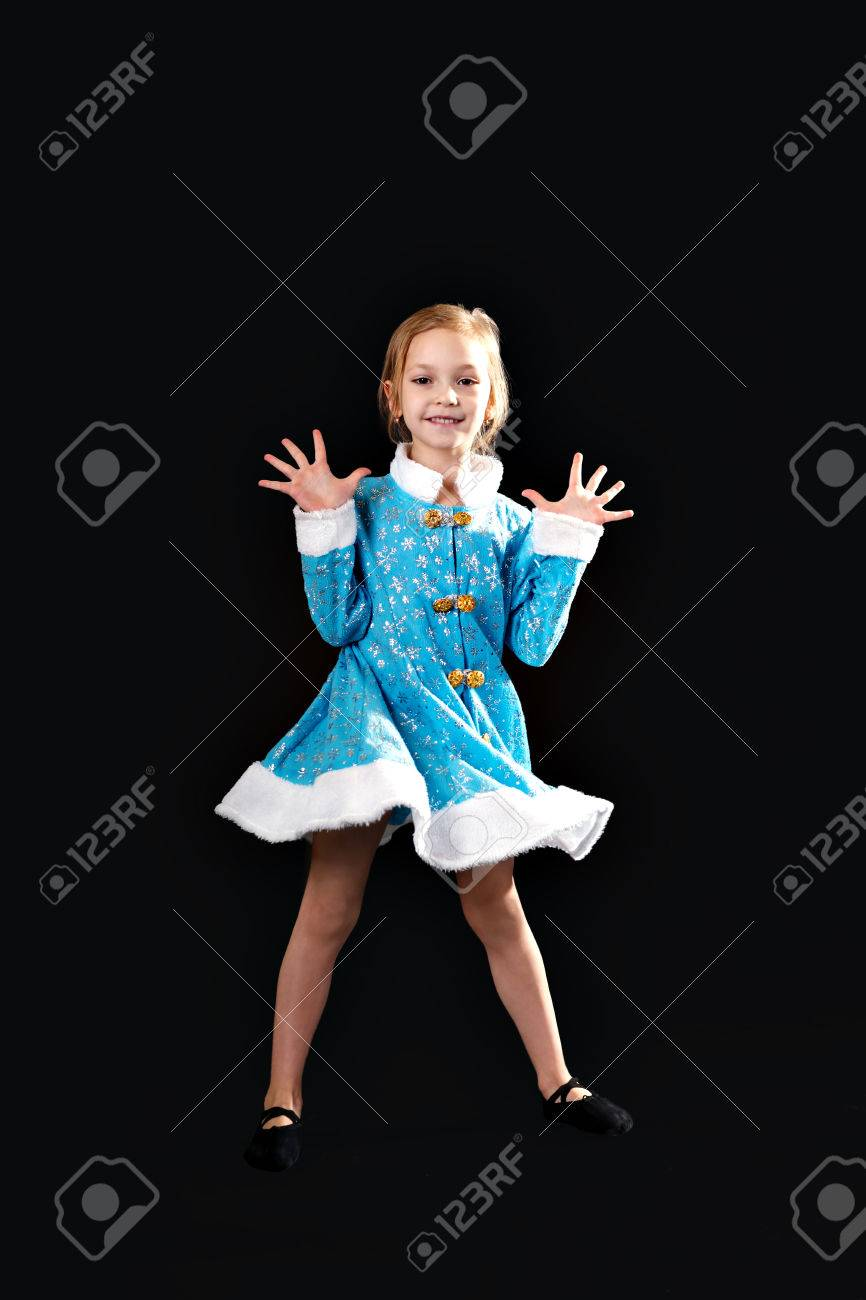 5d29b4f71 Little Girl Jumping In The Air. In The Blue Dress. Black Ballet ...