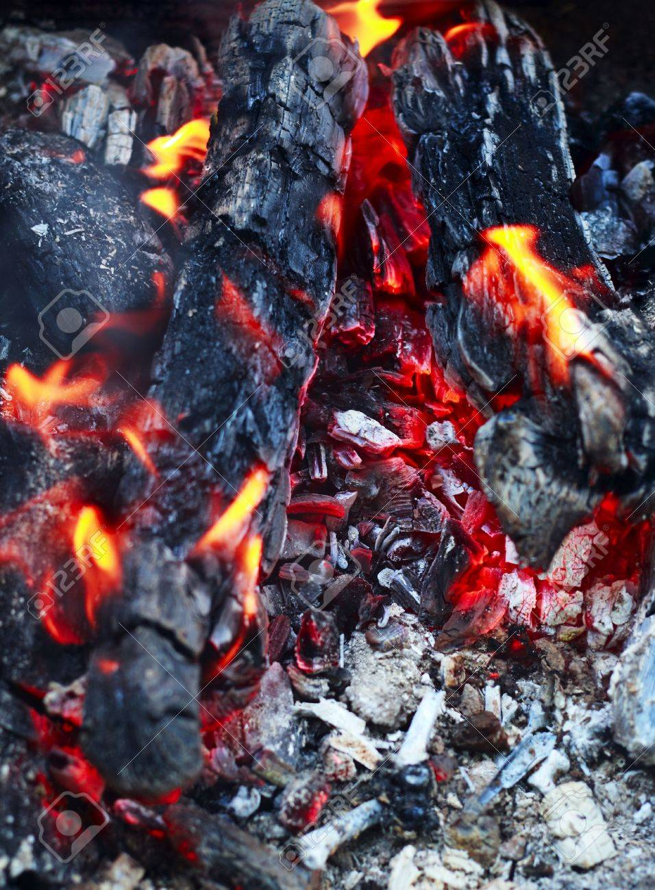 home fireplace red fire and black ash abstract background stock