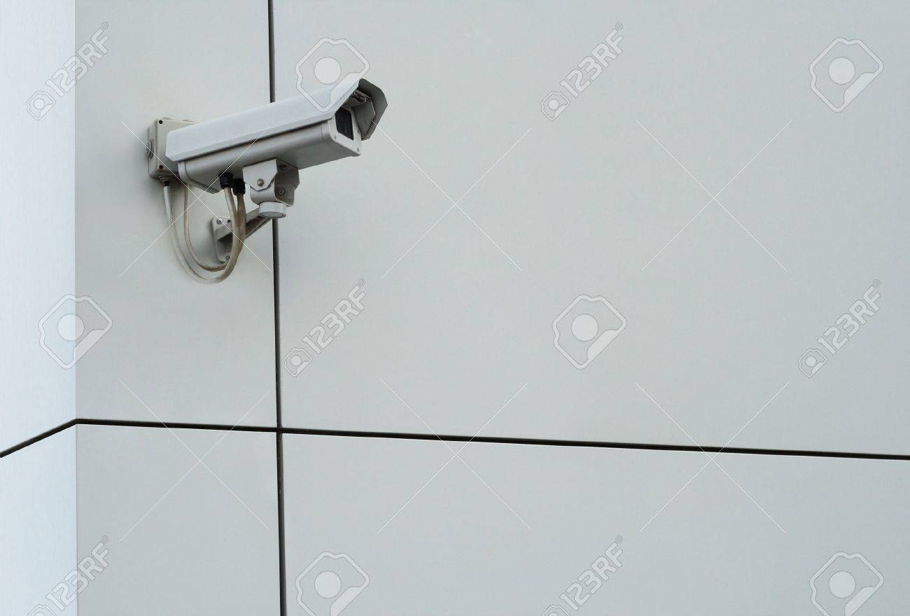 Security camera. Digital camcorder on gray plastic facade wall Stock Photo - 5185311