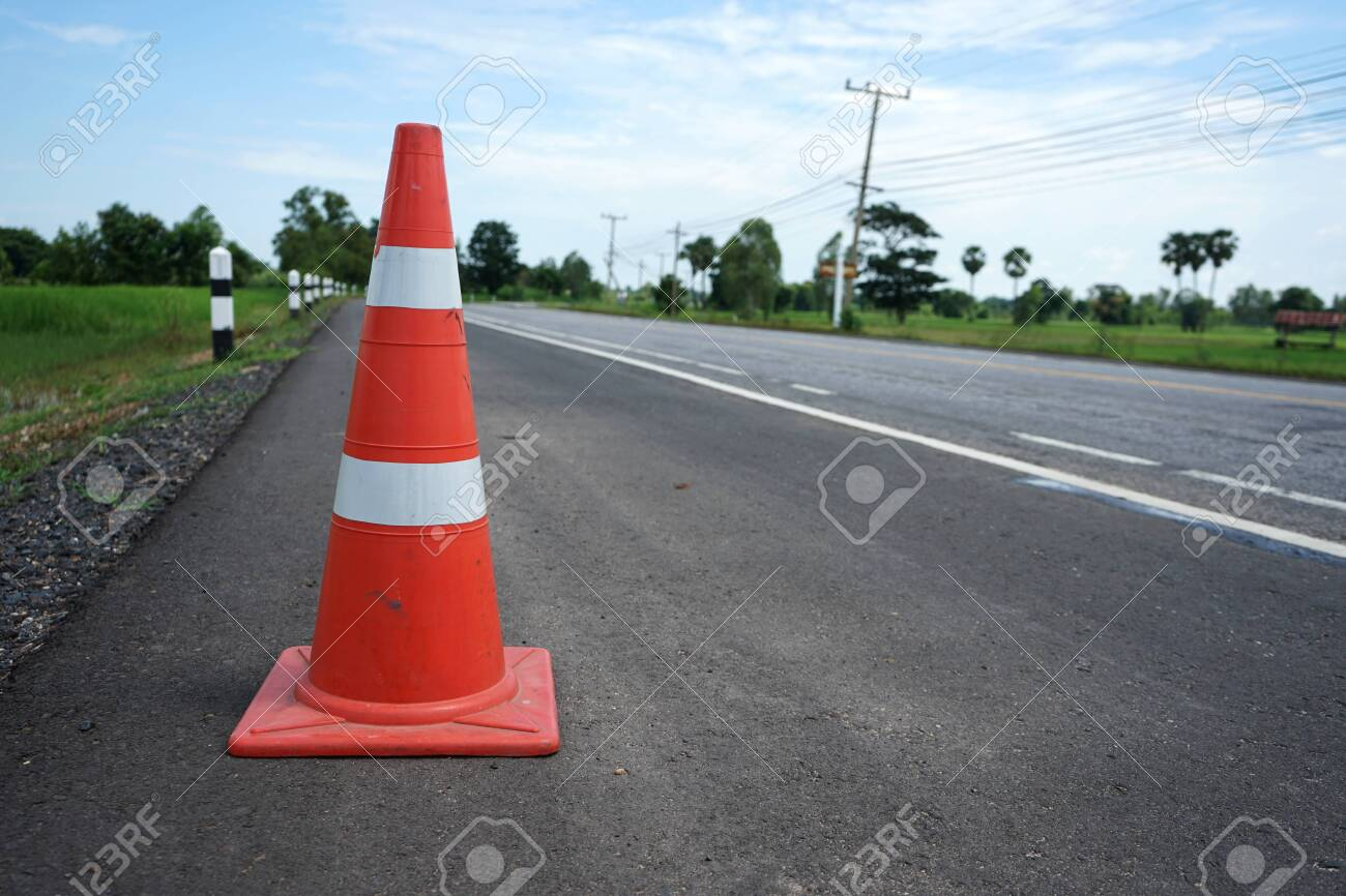 Red rubber cone placed on the road to ensure safety - 132014458