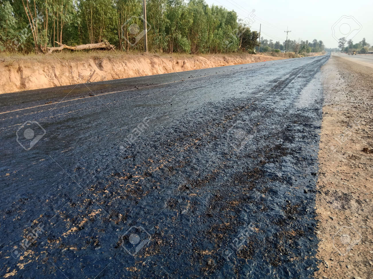 Asphalt spraying Preparing the surface for road construction - 163955717