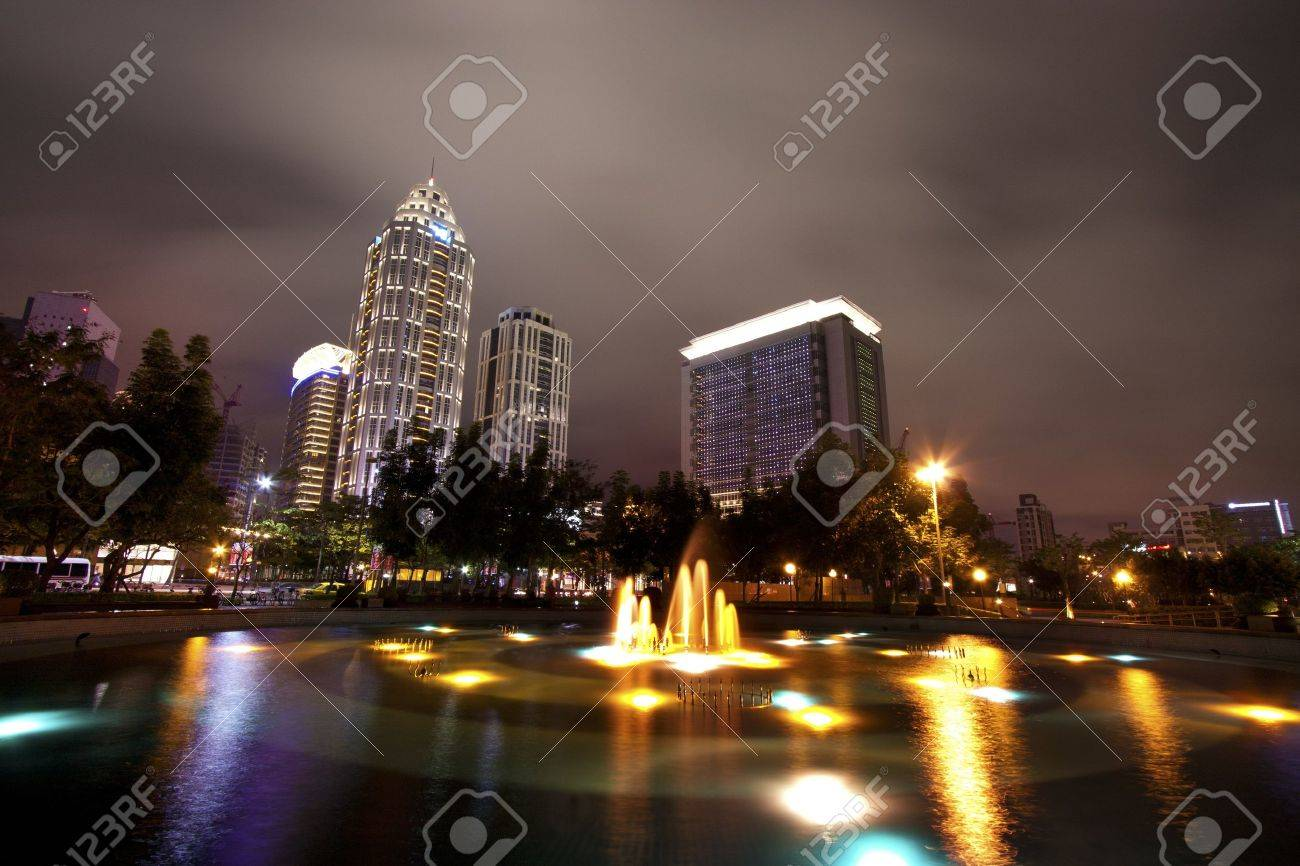 broad view of skyscraper modern building with fountains at night Stock Photo - 13066610
