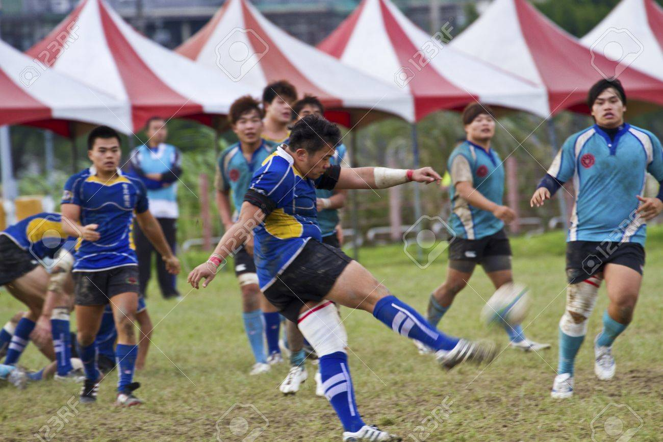TAIPEI,TAIWAN - December 13 : unidentified rugby football players in the All-Taiwan rugby Football Competition in Taipei Bailing Rugby  Fields on December 13,2012 in Taipei,Taiwan Stock Photo - 17051508