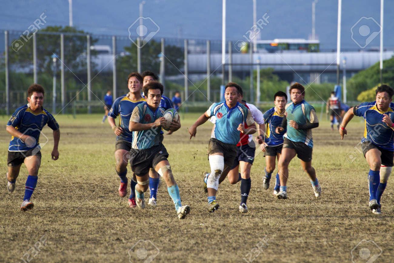 TAIPEI,TAIWAN - December 13 : unidentified rugby football players in the All-Taiwan rugby Football Competition in Taipei Bailing Rugby  Fields on December 13,2012 in Taipei,Taiwan Stock Photo - 17051547