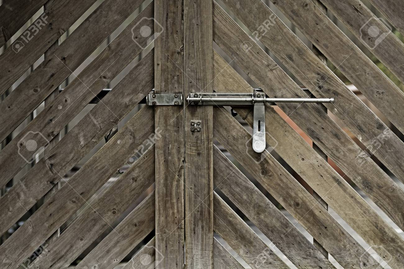 Closeup wooden door with lock in grungy style and good texture Stock Photo - 17635049