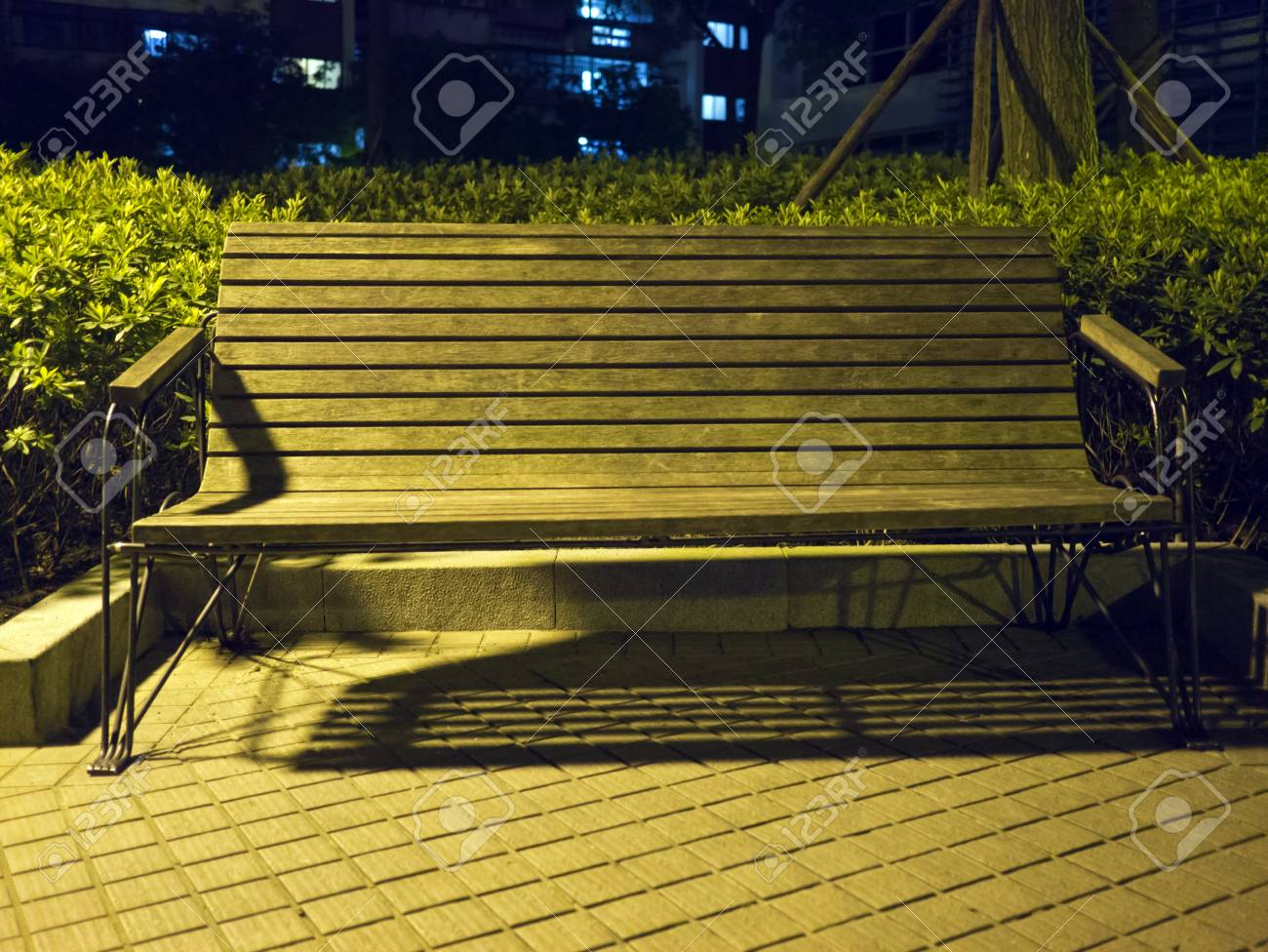 Wooden Park Bench At A Park At Night Stock Photo Picture And