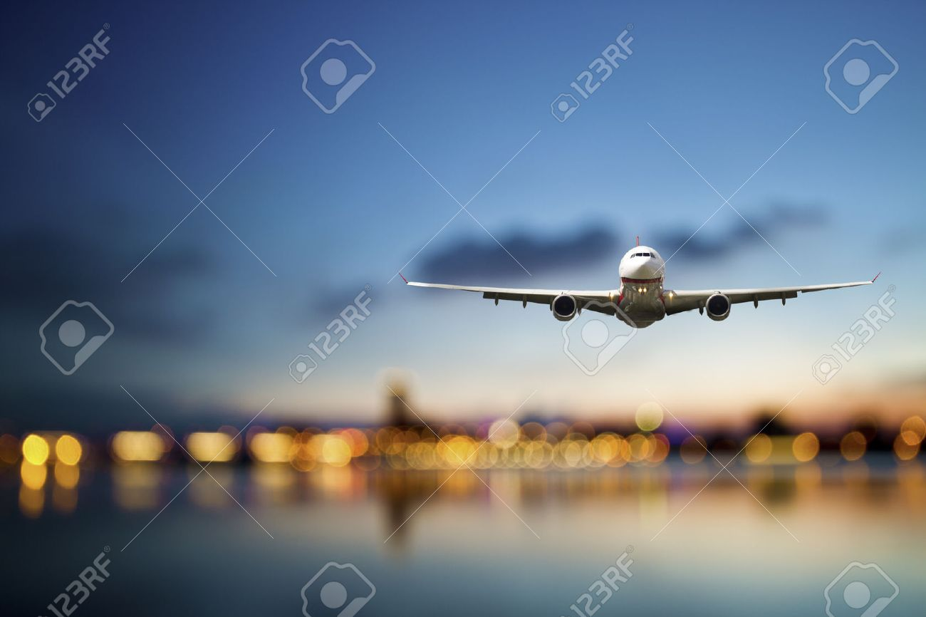perspective view of jet airliner in flight with bokeh background - 27500444