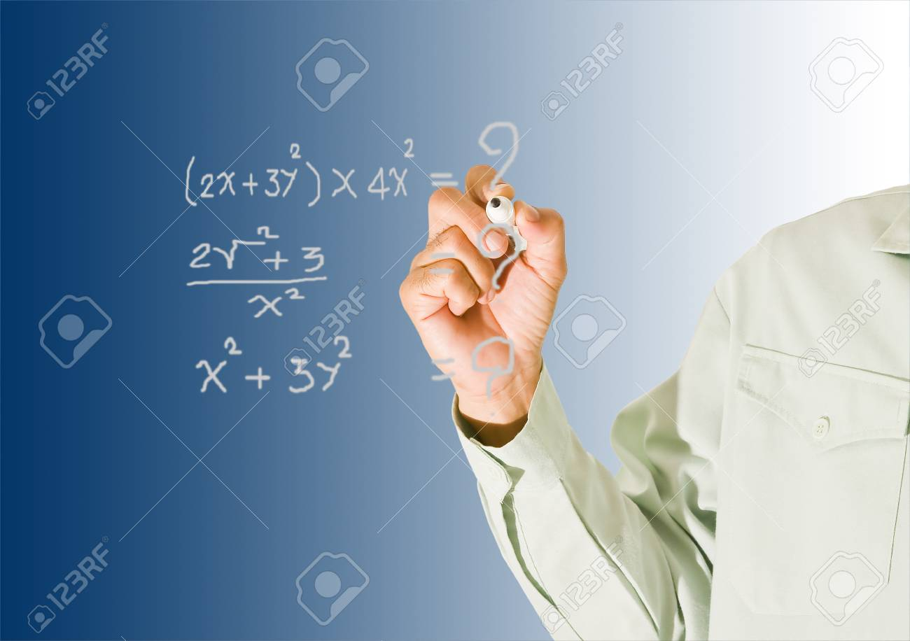 Teacher pointing at board Stock Photo - 10891686
