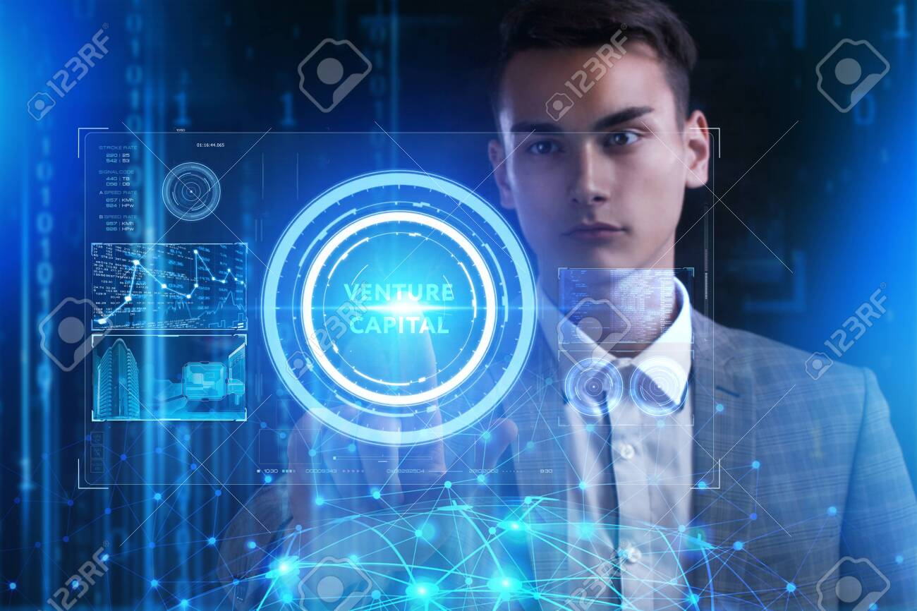 The concept of business, technology, the Internet and the network. A young entrepreneur working on a virtual screen of the future and sees the inscription: Venture capital - 121740377