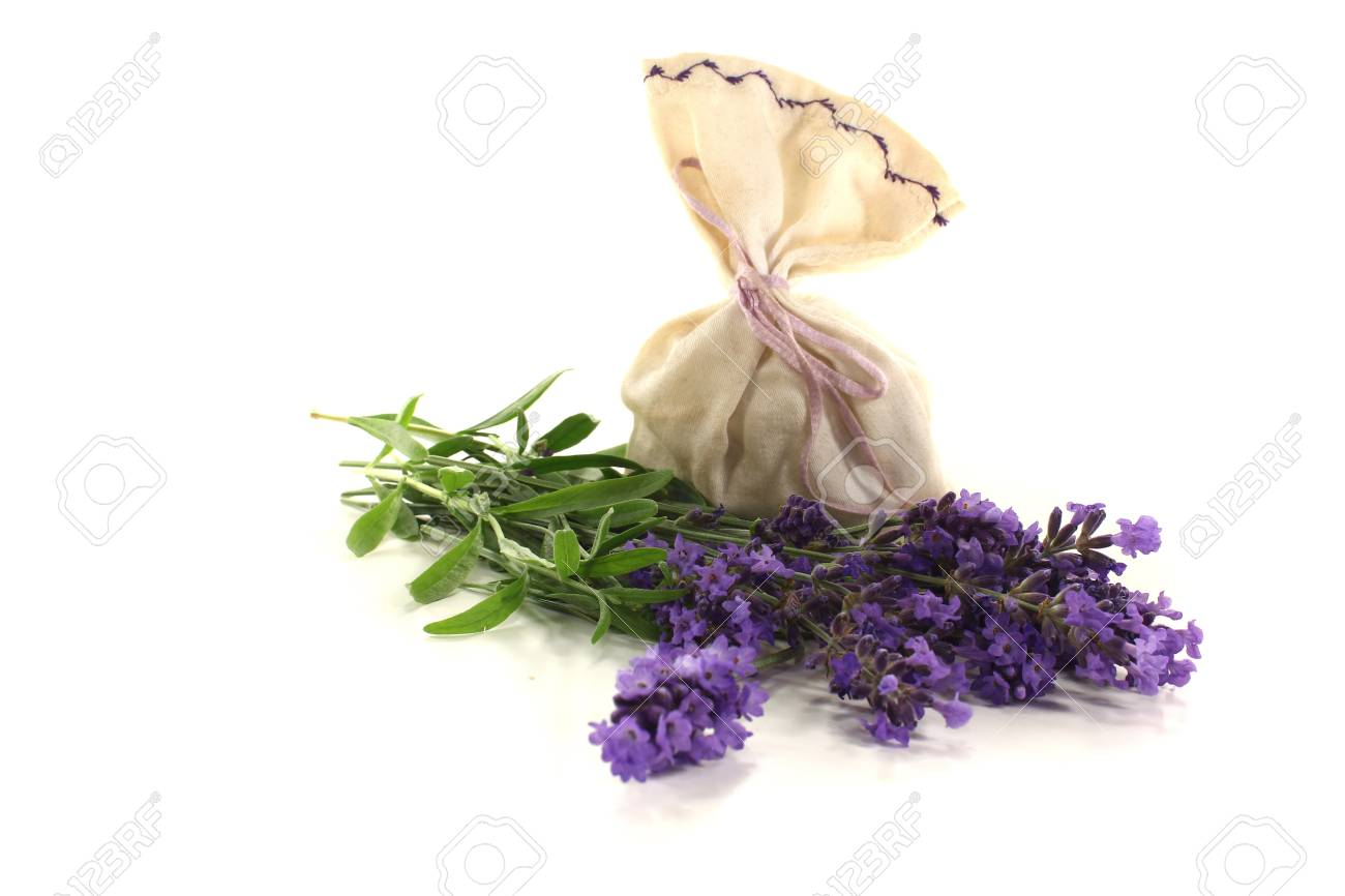 Lavender bag with flowers and leaves on a bright background Stock Photo - 14478913