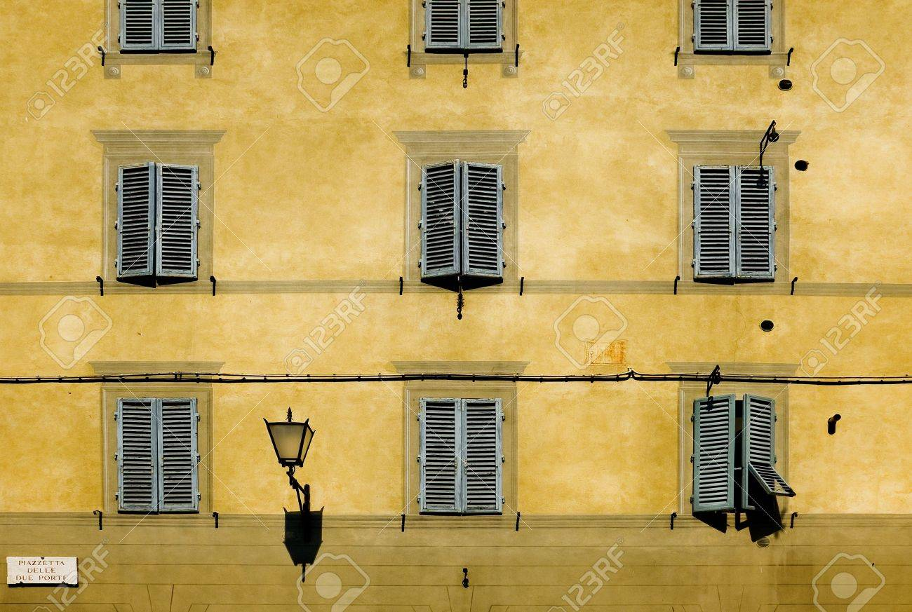 typical facade with windows of tuscan architecture siena, italy