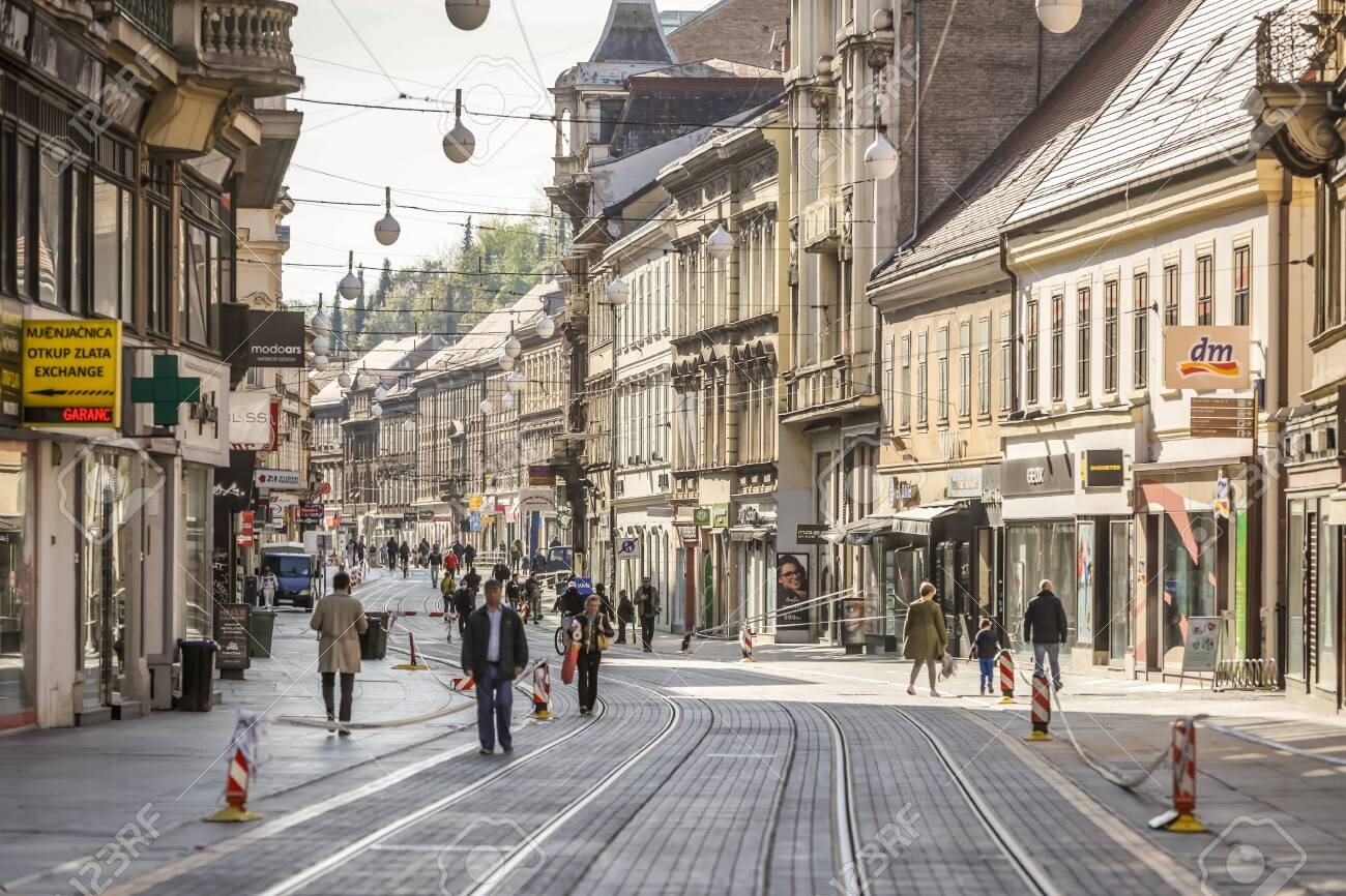 Zagreb, Croatia - 15 April, 2020 : People walking on the Ilica street that is blocked with police tapes and direction ban signs due to a major earthquake that damaged the city in Zagreb, Croatia. - 146815019
