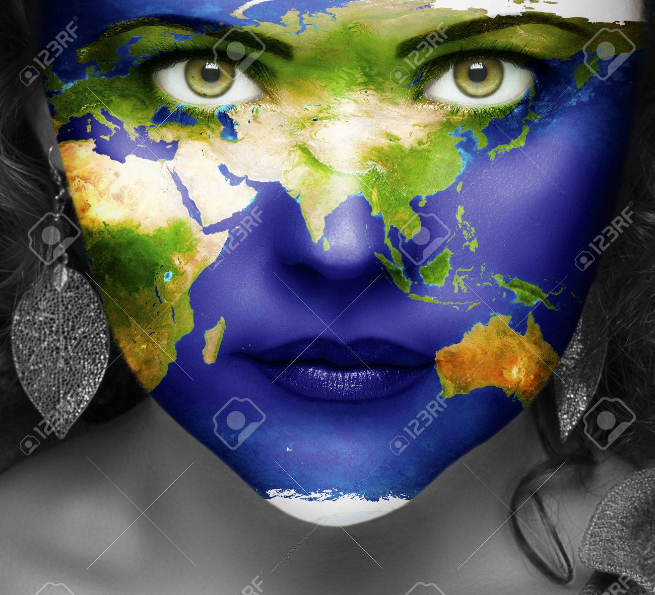 Map Of The World On Face Of Girl With Green Eyes Stock Photo