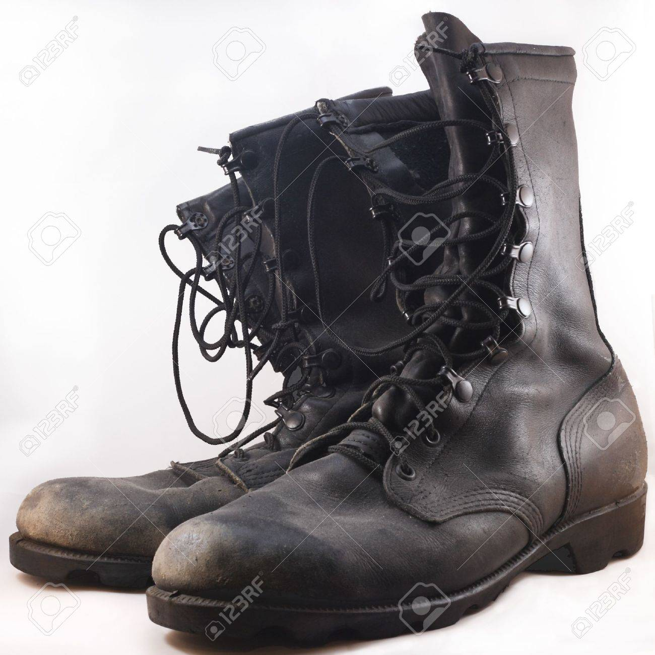 Used Black Leather Combat Boots In Front Of White Background Stock ...
