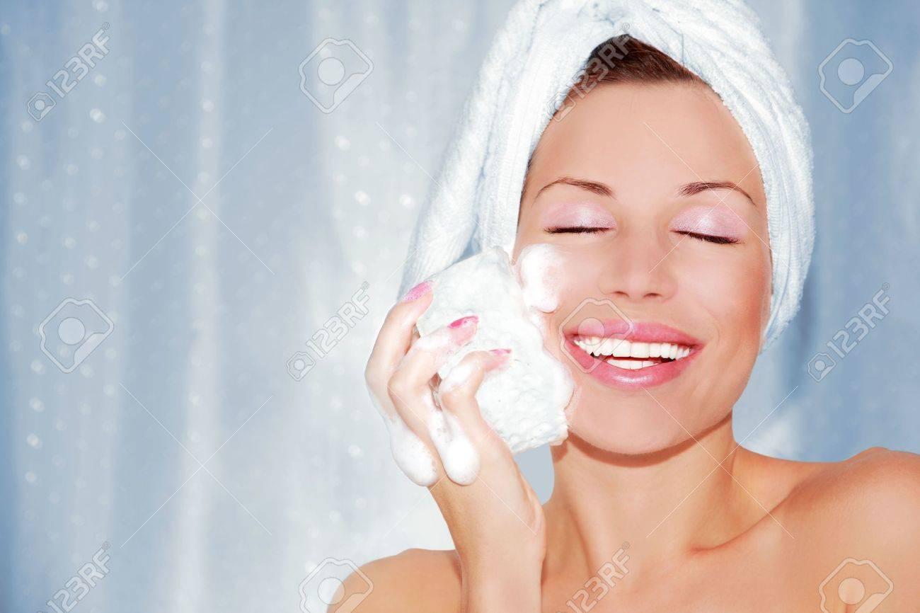 beautiful woman cleaning face. Beauty treatment Stock Photo - 5137019