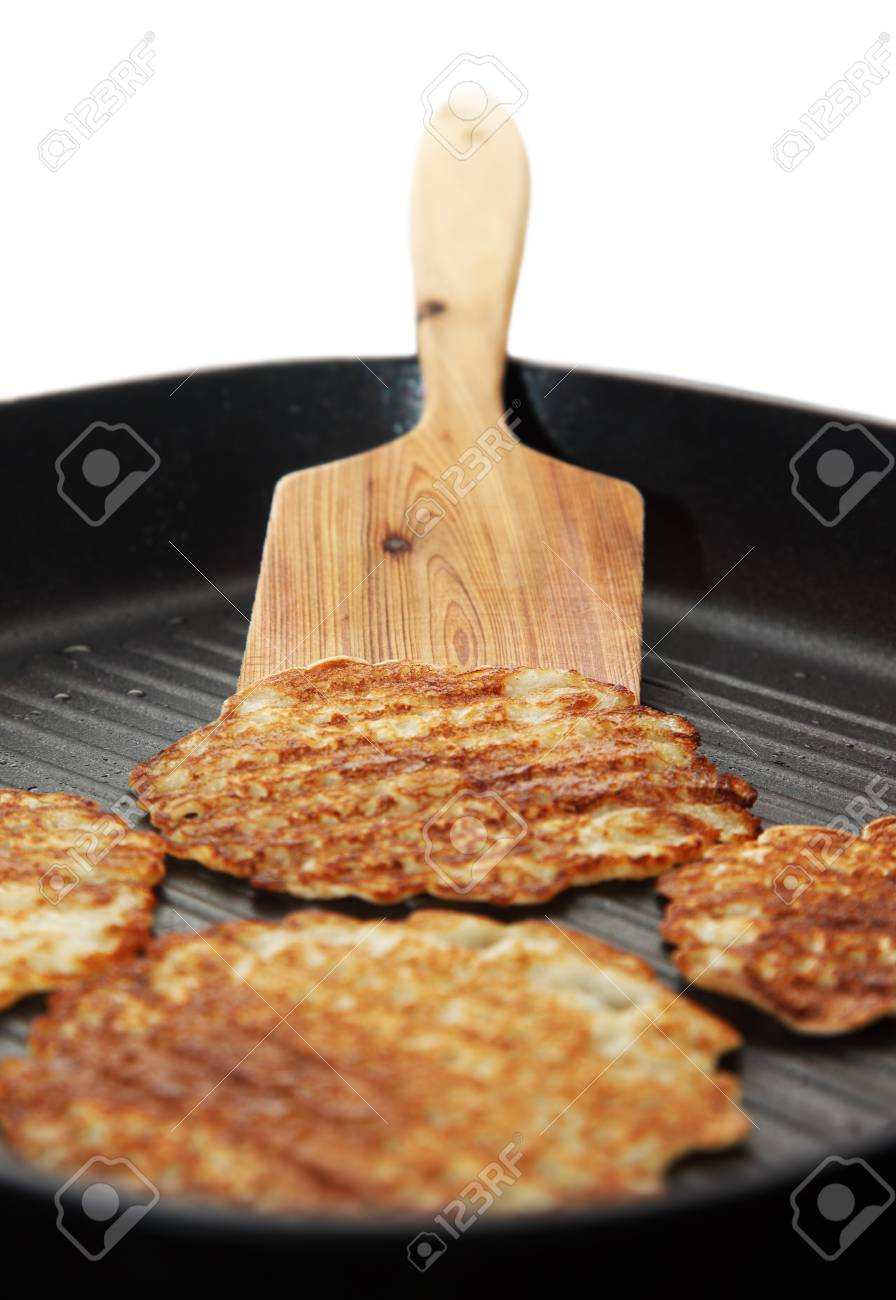 Delicious pancakes on the frying pan over white. Shallow DOF Stock Photo - 7753463