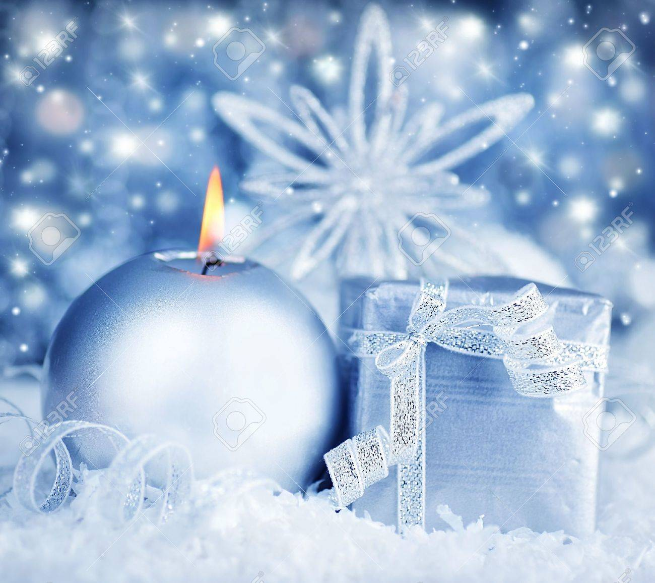 Winter holiday background with silver present gift box, candle ornament & Christmas snow decoration Stock Photo - 8267460
