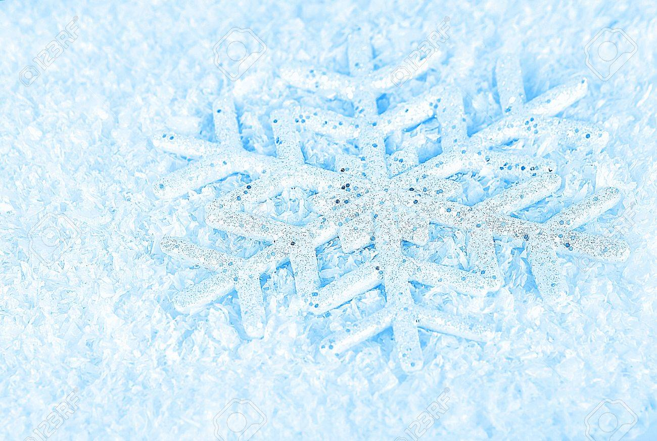 Snowflake, blue winter holiday background, christmas tree ornament & snow decoration Stock Photo - 8499048