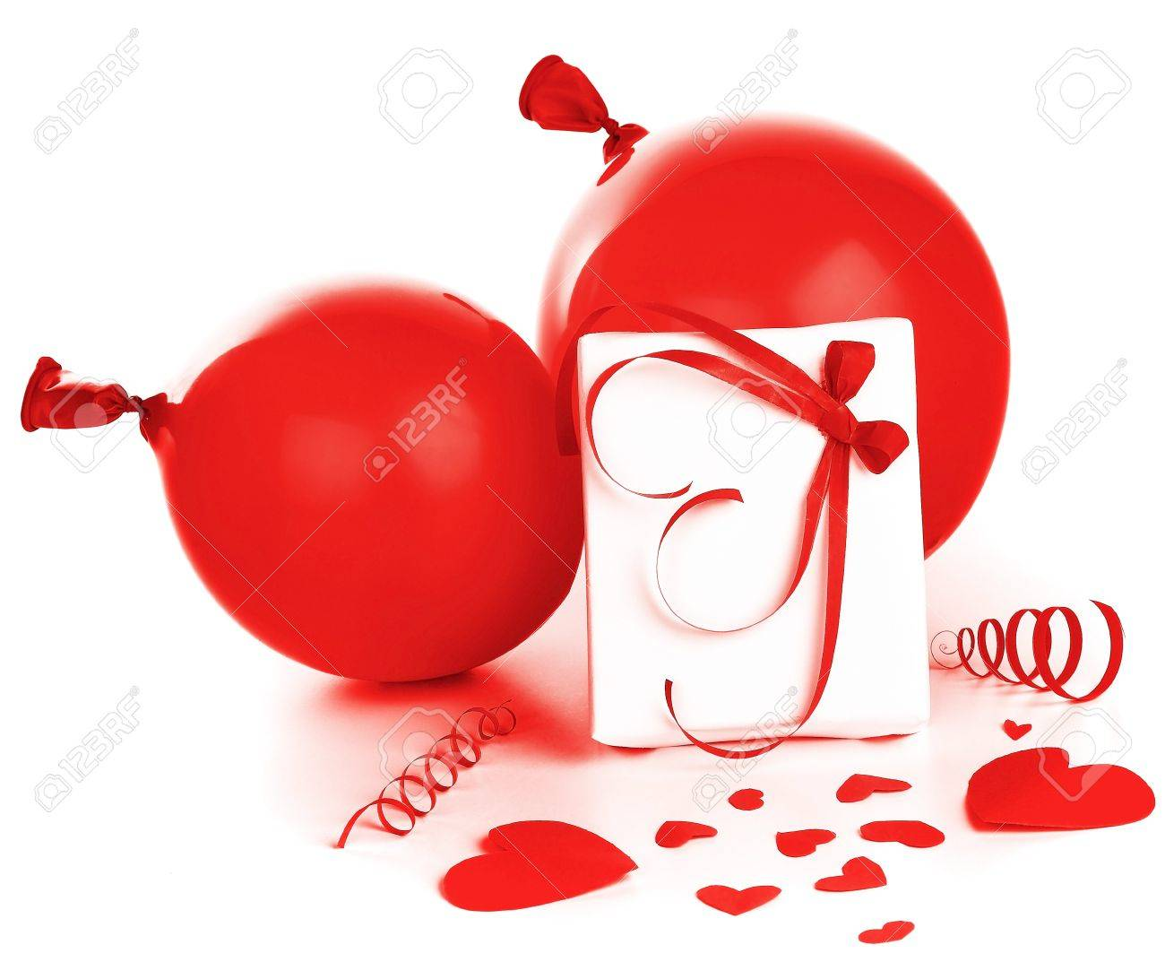 Gift box with red hearts & baloons isolated on white background, conceptual image of love & Valentine's day holiday Stock Photo - 8876011