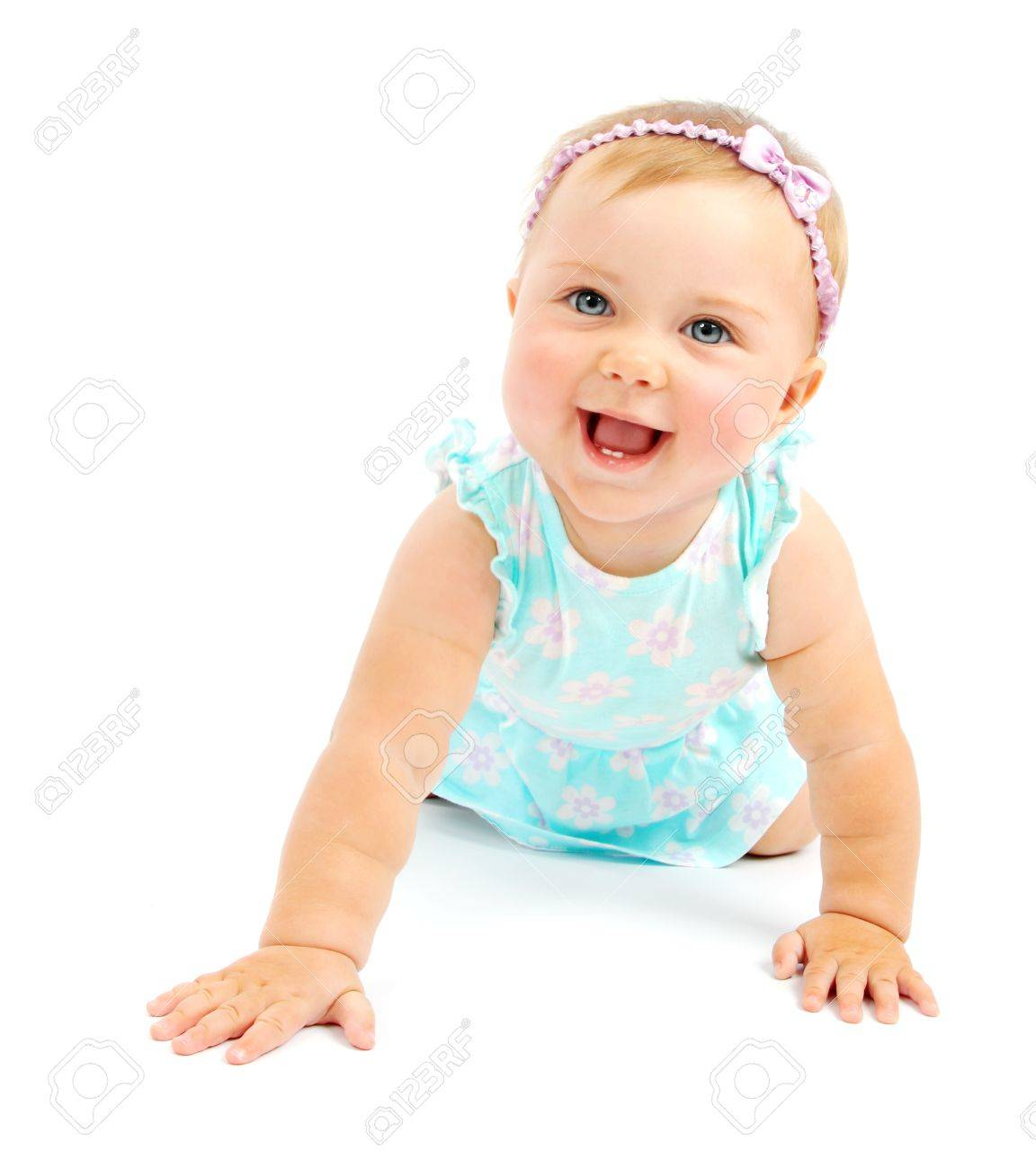 Adorable little baby girl laughing, creeping & playing in the studio, isolated on white background Stock Photo - 8980318