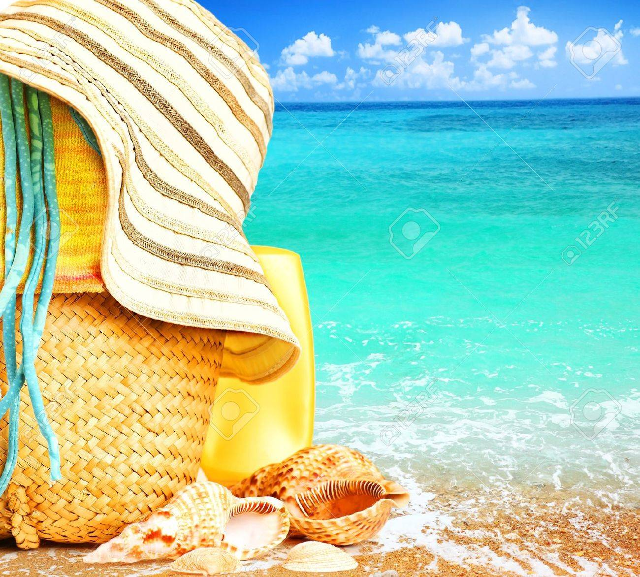 Beach items over blue sea conceptual image of summertime vacation & holidays Stock Photo - 9059357