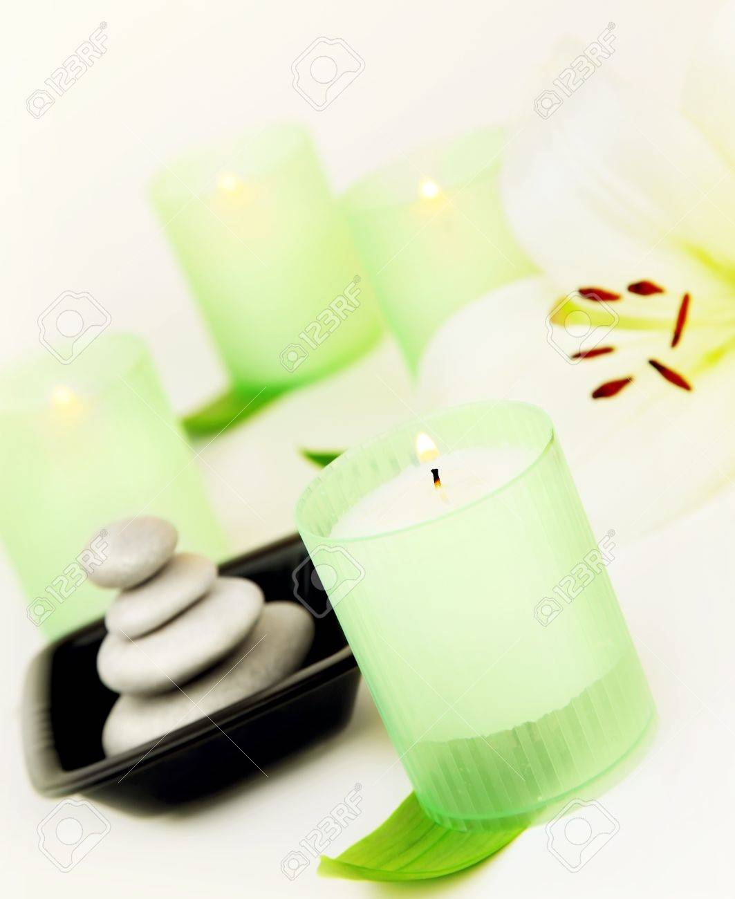 Candles and balanced zen spa stones with lily flower, relaxation vacation concept Stock Photo - 9179225