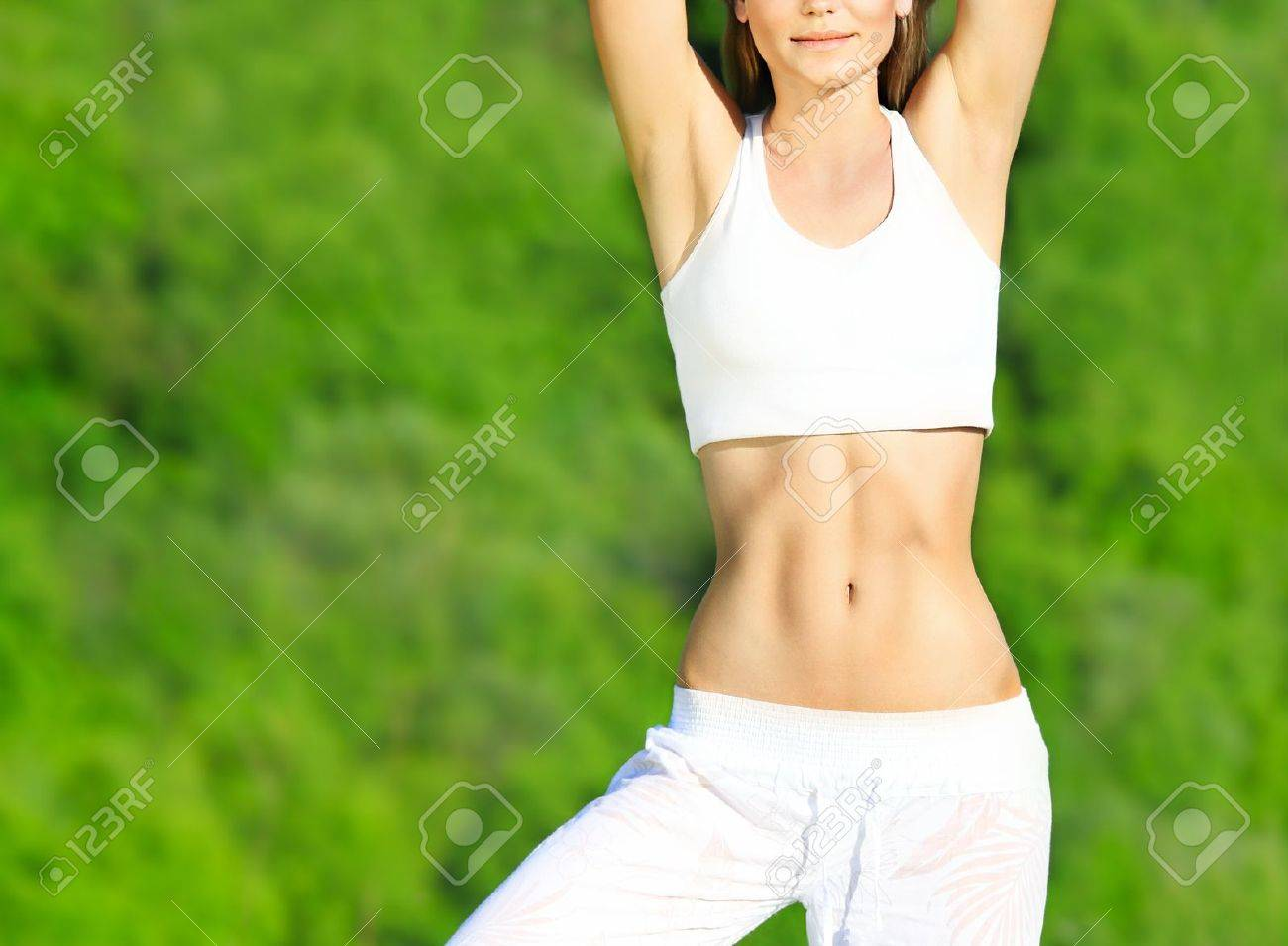 Healthy sport female body over green natural background, body care & fitness concept Stock Photo - 9763223
