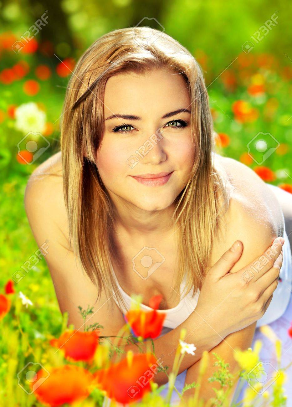 Young beautiful girl enjoying on the poppy flowers field, outdoor portrait, summer fun concept Stock Photo - 9824589