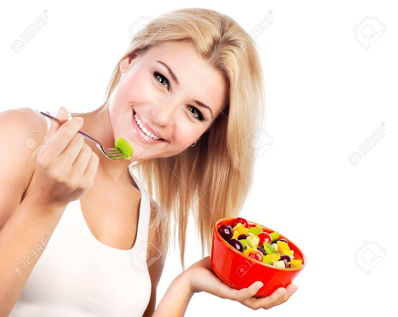 Pretty girl eating fruit salad, healthy fresh breakfast, dieting and health care concept Stock Photo - 9996956