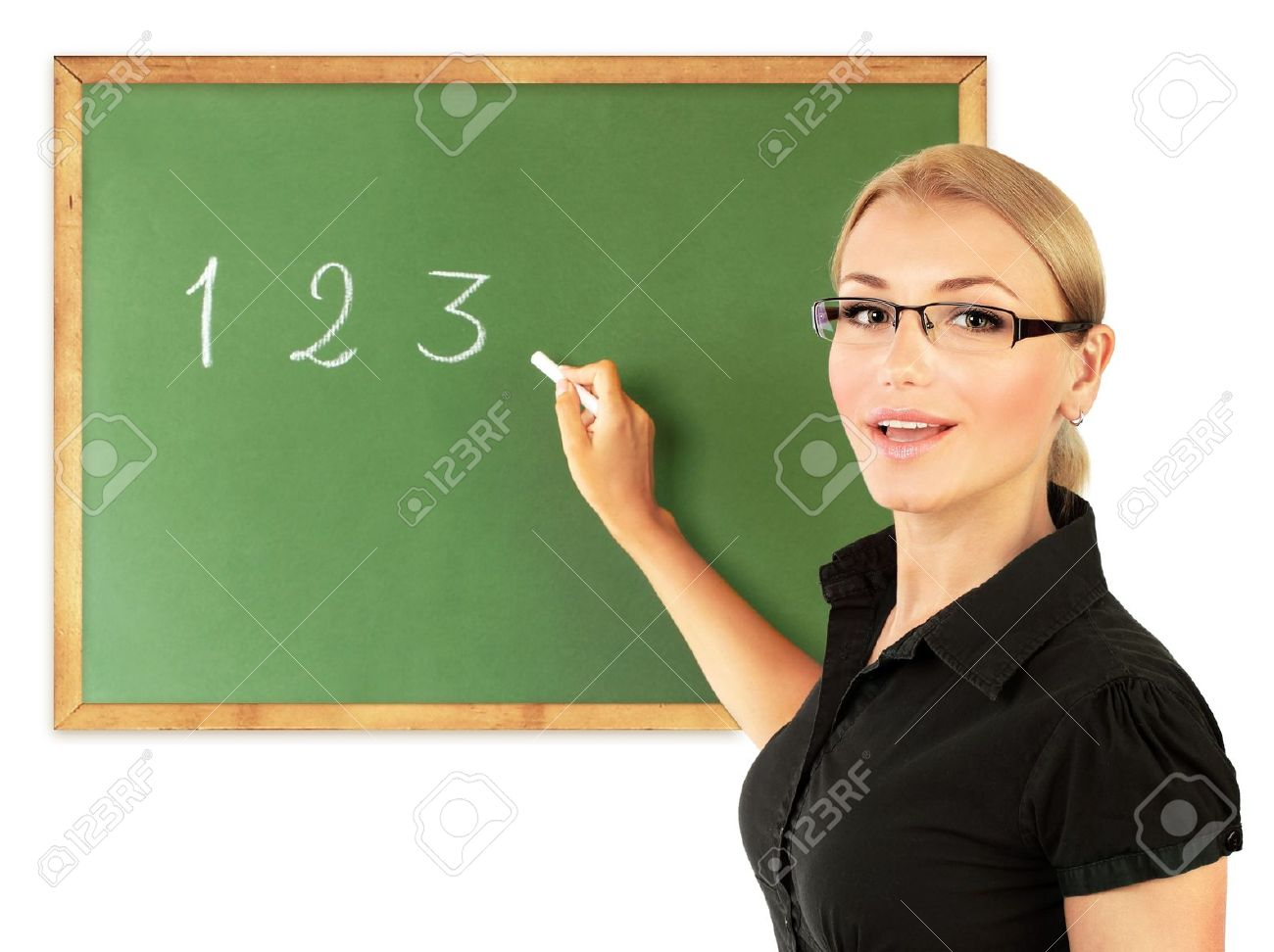 Young Teacher Writing Numbers On The Chalkboard, Isolated On ...