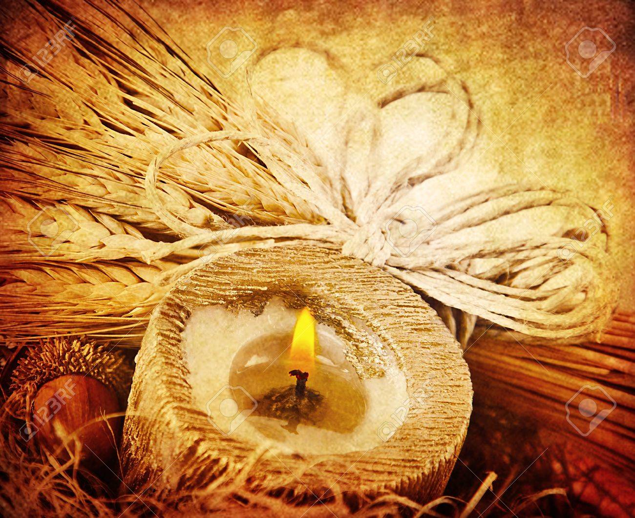 Warm candle light, decoration with wheat, dark grunge autumn background, thanksgiving holiday ornament Stock Photo - 10874985