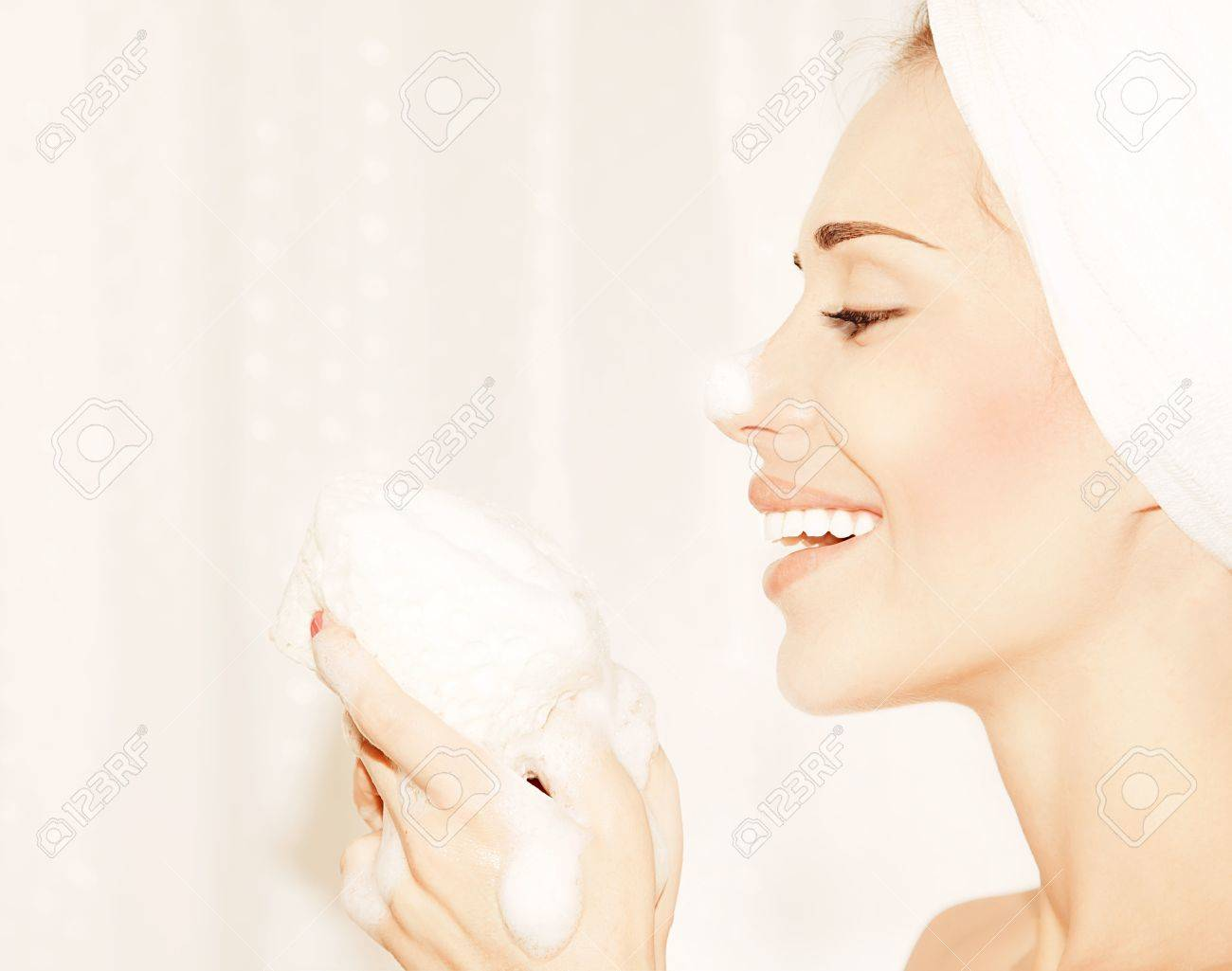 Healthy happy girl taking bath, profile portrait of a beautiful young female cleaning face skin, hygiene and day spa Stock Photo - 10993942
