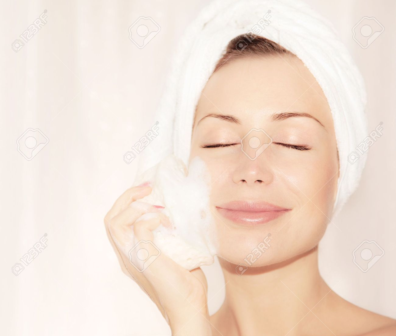 Healthy happy girl taking bath, beautiful young female cleaning face skin,  portrait over soft light background, hygiene and day spa Stock Photo - 10993934