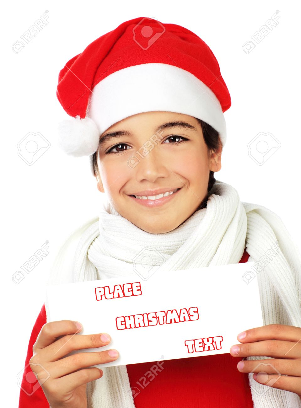 Happy Santa boy smiling, portrait of a cute teen holding blank card isolated on white backgroung, kid wearing red Christmas hat, winter holidays celebration Stock Photo - 11312531