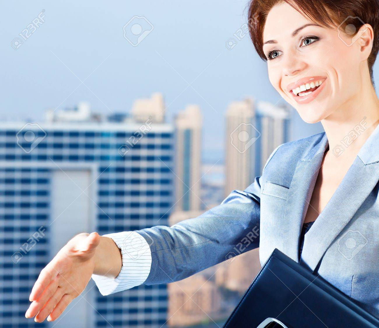 successful businessw making a deal young smart office worker stock photo successful businessw making a deal young smart office worker w over blue sky city background handshake business lifestyle