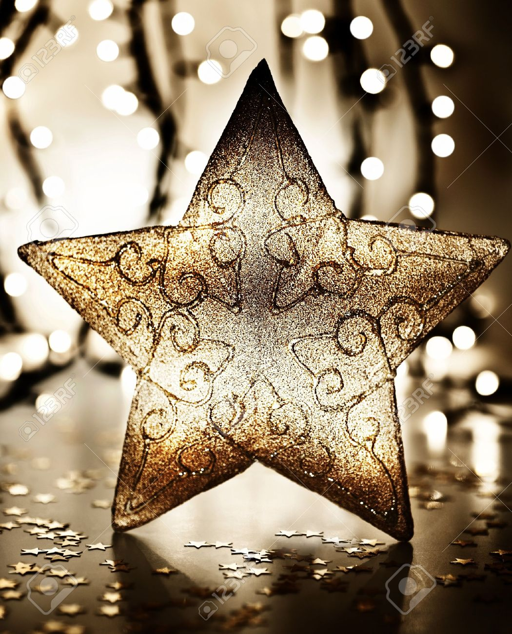 Brown christmas tree ornaments - Star Christmas Tree Ornament Golden Decoration Over Blur Lights Dark New Year Eve