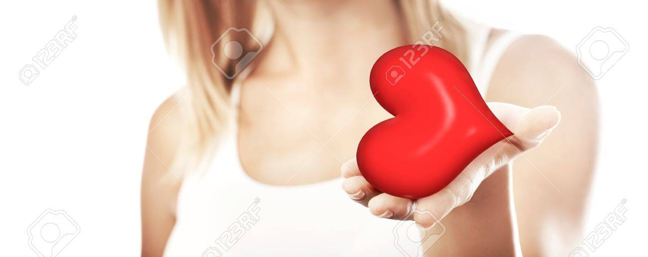 Beautiful woman holding heart in hand, sensual female portrait isolated on white background, cute girl, conceptual image of health care and love, selective focus, shallow dof Stock Photo - 12588448