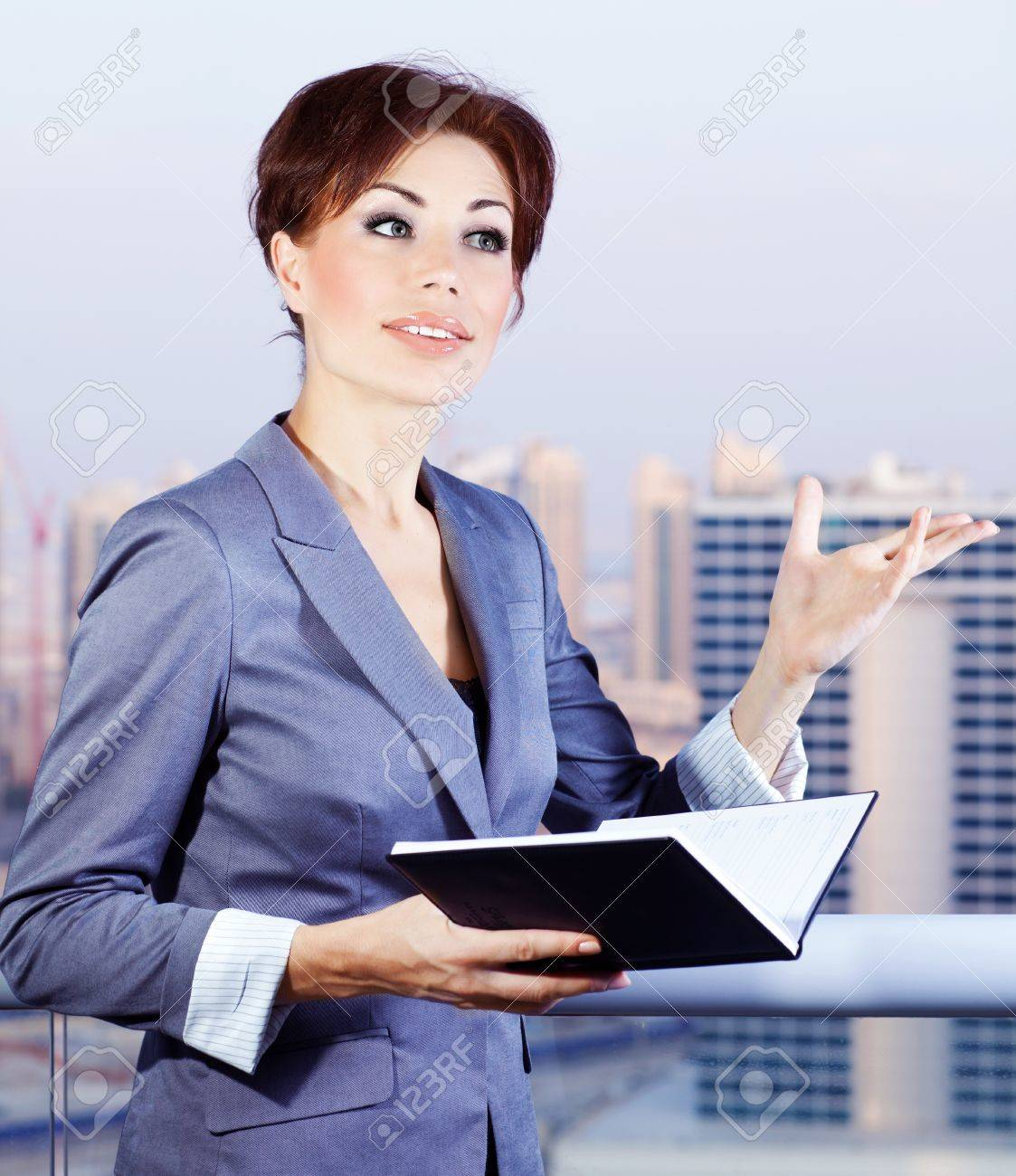successful businessw making a deal young smart office worker stock photo successful businessw making a deal young smart office worker w over blue sky and city background business lifestyle concept