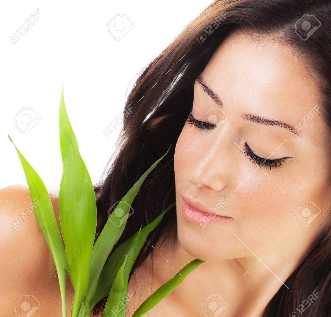 Healthy woman relaxing at spa, sensual female portrait with green fresh leaves, young lady with spring plant, girl isolated on white background, skin care concept Stock Photo - 12589042