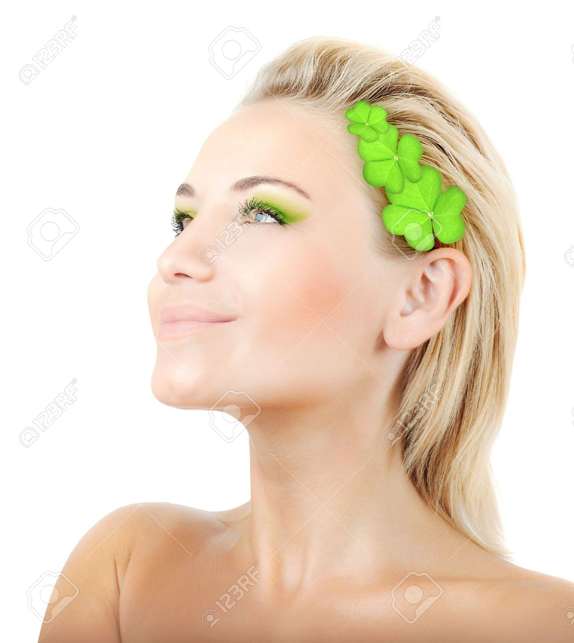 Beautiful woman with wreath of clover, fresh green plant leaves in blond hair, female face portrait isolated over white background, pretty girl with bright makeup, st. Patrick's day, spring holiday Stock Photo - 12589153
